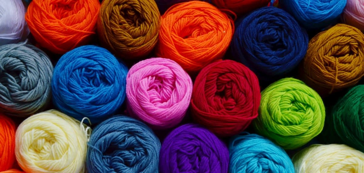 Blurry background of colorful knitting. View from above of colorful knitting.